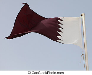 Qatari flag - The national flag of Qatar in the Arabian...