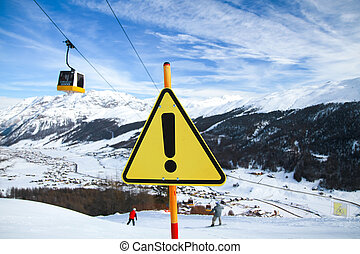 Yellow Warning Sign on Ski Slope