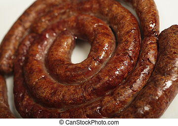 A grilled boerewors sausage on a plate - Close-up on a...