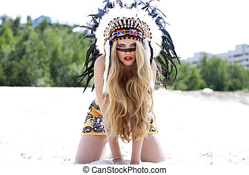 Blonde woman in costume of American Indian