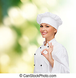 smiling female chef showing ok hand sign - cooking, gesture...