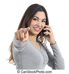 Woman pointing at camera calling on the mobile phone...