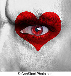 Love background - human face with red heart on eye