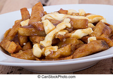 Poutine quebec meal with french fries, garvy and cheese...
