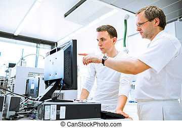 Team of researchers carrying out experiments in a lab...