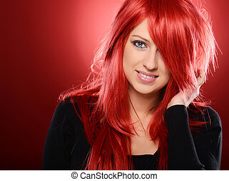 Pretty girl - Beautiful red haired woman posing over red...