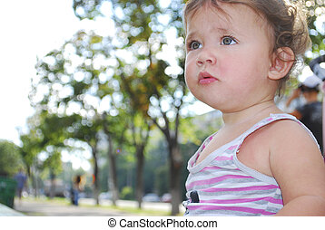 Little funny girl on the street.