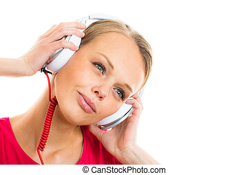 Pretty, young woman listening music - Pretty, young woman...