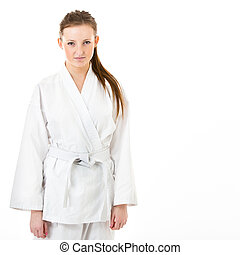 Beautiful caucasian, young, woman in karate kimono on white...