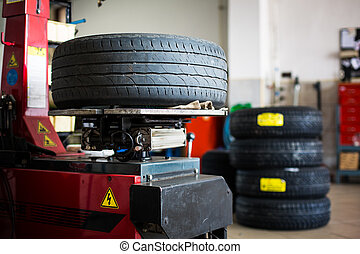 Inside a garage - changing wheels/tires (shallow DOF; color...