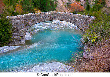 Rio Ara river and bridge San Nicolas de Bujaruelo in Ordesa...