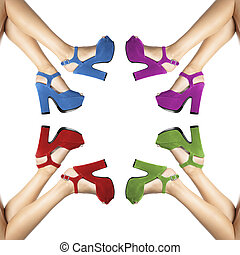legs and feet of a woman with colored shoes in circle on...