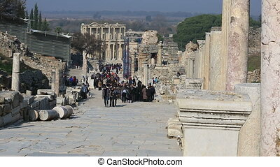 Ephesus Ancient City - tourists visiting columns street...