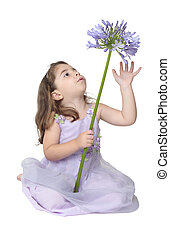 Little girl playing with flower