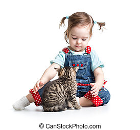 kid girl playing with cat kitten
