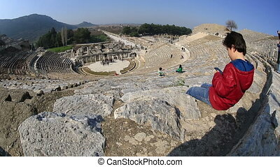 Ephesus Ancient City - bored kid use smartphone in...
