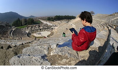 Ephesus Ancient City - bored kid use digital tablet in...