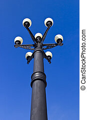 Streetlight in the bright sunny day on the empty street
