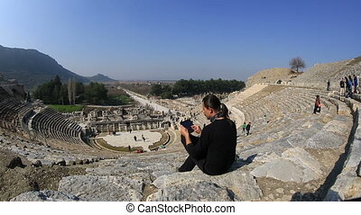 Ephesus Ancient City - tourist use digital tablet in...
