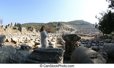 Ephesus Ancient City - attractive blonde tourist video...