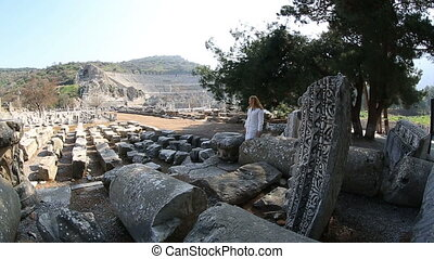 Ephesus Ancient City - attractive blonde tourist visiting...