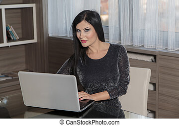 Young woman with laptop in the room