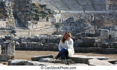 Ephesus Ancient City - attractive blonde tourist talking...