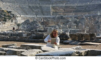 Ephesus Ancient City - attractive blonde tourist taking...