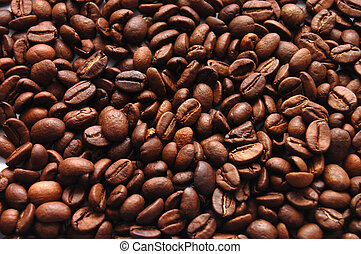 The top view on a background from coffee grains