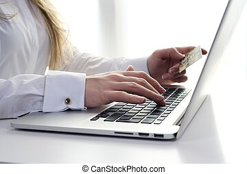 Business woman buying online - A business woman using credit...