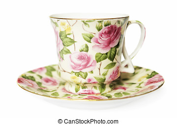 teacup on sucer decorated with pink roses...