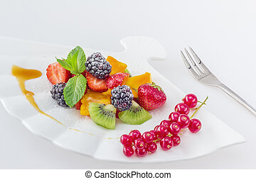 Diet, healthy colorful fruit salad in the white plate