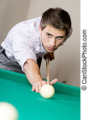 Man playing billiard at gambling club