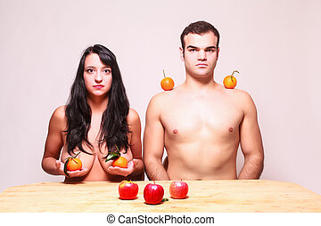 Nude man and woman posing with fres - Conceptual image of a...