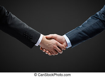 Close up shot of handshake of business people. Concept of...