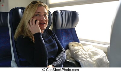 passenger talking phone in train