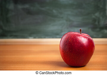 school concept - focus point on nearest part of apple...