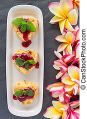 Cottage-cheese Baked Pudding in heart shape with frangipani flowers