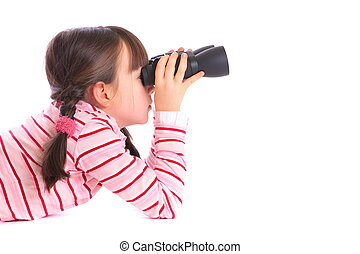 Girl using binocular - Cute girl lying on ground looking...