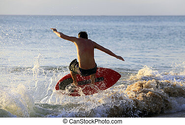 surfer on sunset - Young men - the surfer in ocean. Bali....
