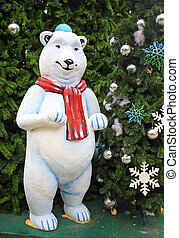 white teddy bear with decorations under the Christmas tree -...