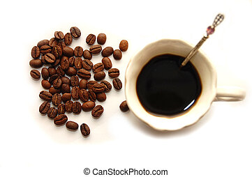 The top view on coffee grains with a coffee cup