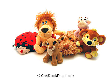 Different soft toys on a white background