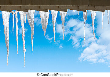 Beautiful icicles - Icicles hanging from the roof against...