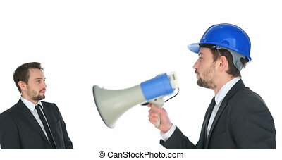 Man shouting at himself with a megaphone - Businessman in a...