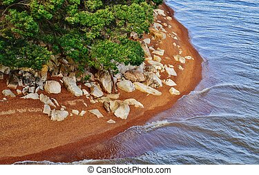 Lake shore - Landscape with lake shore and red sand