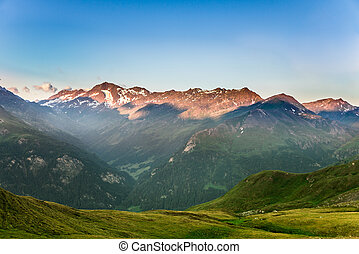 beautiful view of the Alps in the morning with green meadows...