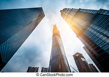 The construction site fo Shanghai Tower - Three skyscrapers...