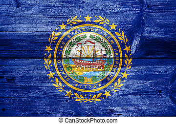 New Hampshire State Flag painted on old wood plank texture