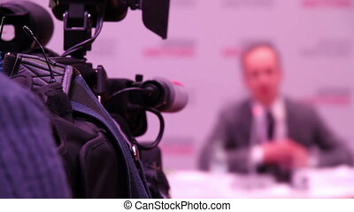 Speaker at the Conference - Television camera focused on a...